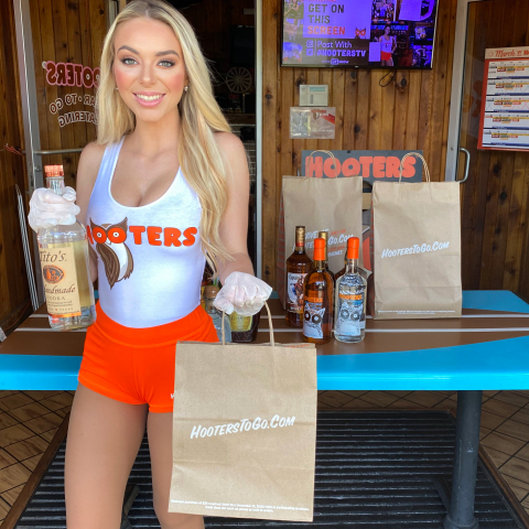 In an effort to help keep everyone safe, Hooters is providing a convenient, worry-free option for customers to get their favorite wings – as well as beer, wine and spirits in participating states – through Hooters new curbside pick-up. (Photo: Business Wire)