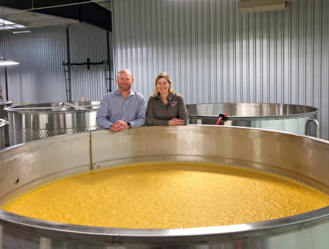 Co-owners Pete and Vienna Barger of Southern Distilling Company, pictured here by a fermentation tank containing corn mash, have shifted their craft distillery's large-scale production from whiskeys to hand sanitizer to help address the current shortage. (Photo: Southern Distilling Company)