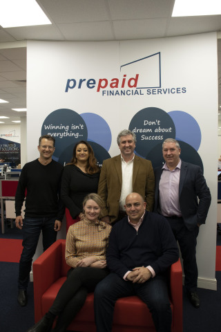 High-res image taken in PFS' new Ireland office in Trim, Co. Meath in January 2020: Back row, left to right; Paul Wenk, Group General Counsel at EML, Valerie Moran, Head of Operations & Client Relations at PFS, Tom Cregan, Managing Director & Group CEO at EML, and Noel Moran, CEO at PFS. Front row, left to right; Kristen Shaw, Group Chief People & Culture Officer at EML, and Richard Anderson, Chief Sales & Marketing Officer at EML. (Photo: Business Wire)