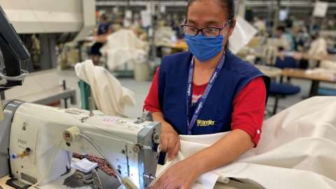 Kontoor Brands is producing patient and disposable isolation gowns at its owned and operated facilities in response to the COVID-19 pandemic. (Photo: Business Wire)