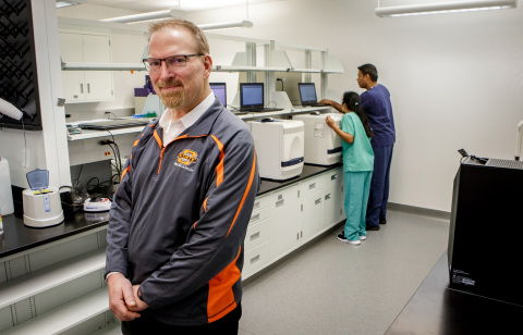 Dr. Kenneth Sewell, Dean of Research at Oklahoma State University, stands inside a laboratory where patient samples are being analyzed for COVID-19 on the campus of Oklahoma State University in Stillwater, Okla. (Photo: Business Wire)