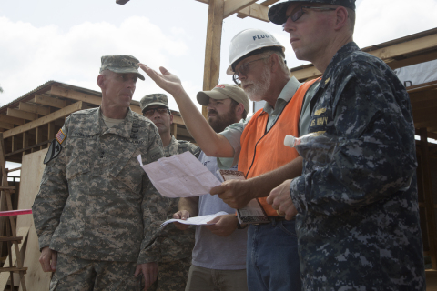 Fluor employees on LOGCAP IV Africa review and discuss a project with the U.S. Army. (Photo: Business Wire)