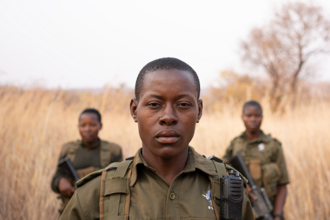 Petronella Chigumbura (center), a member of the all-female anti-poaching unit called Akashinga, stands with other rangers. (Credit: National Geographic/Kim Butts)