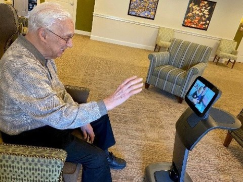 Maplewood Senior Living resident connects with family using Temi powered by Connected Living (Photo: Business Wire)