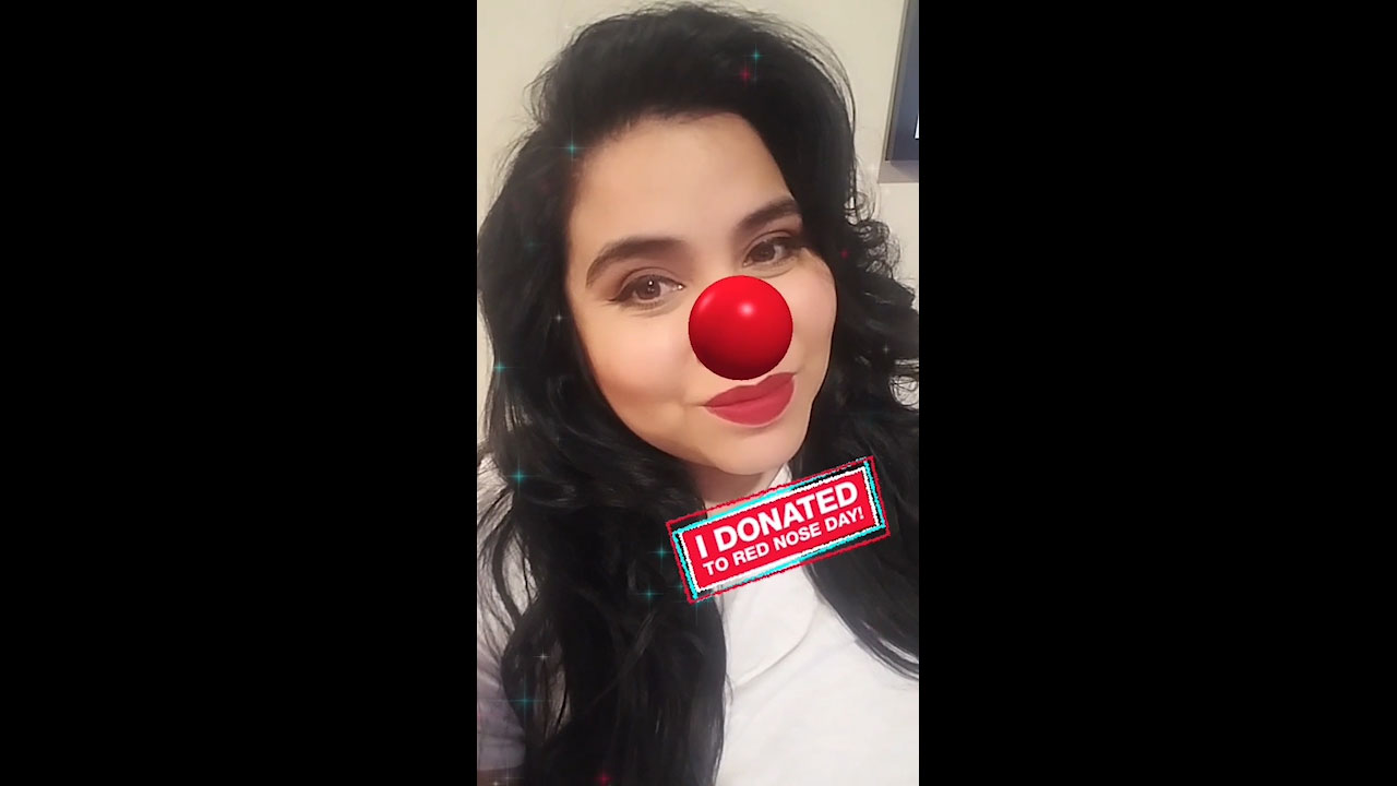 Woman shares selfie wearing digital Red Nose on social media after donating to Red Nose Day at Walgreens.com/RedNoseDay