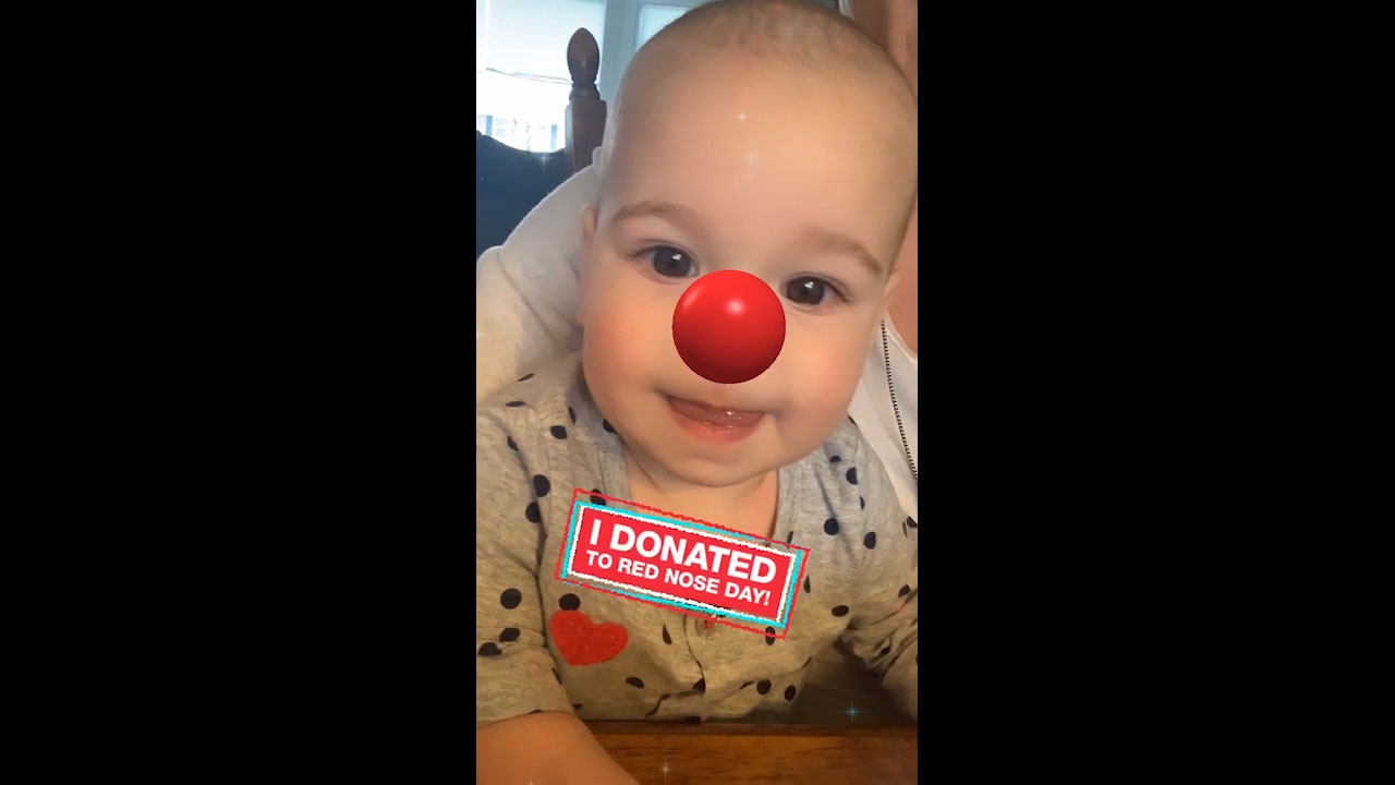 Baby poses wearing Red Nose social media filter in support of Red Nose Day. Donate at Walgreens.com/RedNoseDay