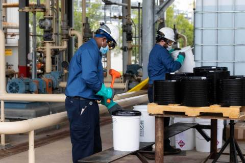 To enhance safety, ExxonMobil plant personnel package the sanitizers outdoors. The new manufacturing process upholds all safety requirements and the consumer-ready product meets FDA standards. (Photo: Business Wire)