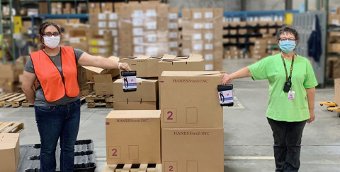Easter Bernal and Phyllis Gentry, HanesBrands distribution center employees, packed up 1,000 pairs of Hanes Hosiery ComfortSoft leggings for donation to GLAM4GOOD, a nonprofit dedicated to empowering people in need. The leggings will be distributed to New York City homeless shelters to help some of its most vulnerable residents during the COVID-19 pandemic. (Photo: Business Wire)