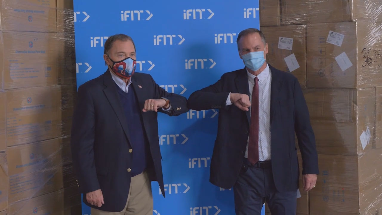 iFit CEO Scott Watterson (right) presents Utah Governor Gary Herbert with a donation of one million medical-grade surgical masks.