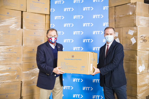 iFit CEO Scott Watterson (right) presents Utah Governor Gary Herbert with a donation of one million medical-grade surgical masks. (Photo: Business Wire)