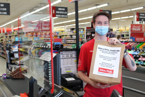 Now through May 15, BI-LO, Fresco y Más, Harveys Supermarket and Winn-Dixie customers can help neighbors in need by purchasing a $5 hunger relief donation bag of non-perishable food items at all store registers. (Photo: Business Wire)