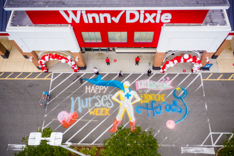 Winn-Dixie honors heroic nurses during National Nurses Week with chalk art and sweet treats. Photographed: Winn-Dixie store No. 7 in Jacksonville, Florida chalk art in partnership with local Ian & Danielle Cleary with Heartspace432. (Photo: Business Wire)