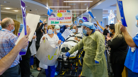 Staff at Northern Westchester Hospital in Mount Kisco, NY, cheer on Friday's release of a patient who recovered from COVID-19, symbolically marking the 10,000th discharge of a patient treated for the Coronavirus at a Northwell hospital since the pandemic struck New York in March. (Credit: Northwell Health)