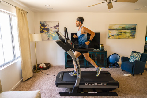 Ultrarunner Zach Bitter on the NordicTrack treadmill in his home living room, where he will attempt to set a new world record for fastest 100 miles on a treadmill. (Photo: Business Wire)