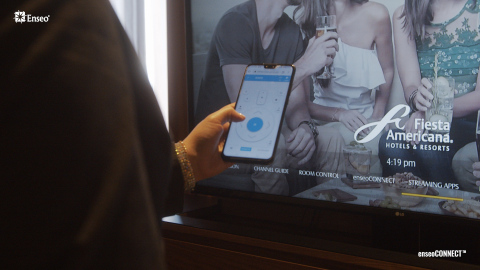 A guest navigates the TV options using the enseoCONNECT™ mobile remote on their own smartphone. (Photo: Business Wire)