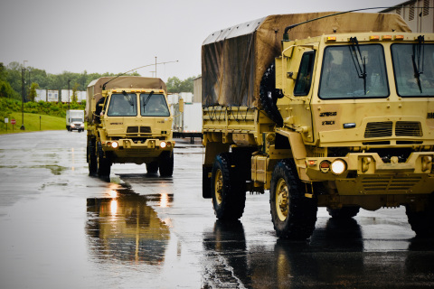 Two Virginia National Guard light medium tactical vehicles arrive at HanesBrands distribution center near Winston-Salem to load 50,000 Hanes face masks weighing 1,280 pounds. The masks will be included in care packages to be given to residents of Henrico County, Virginia, over the Memorial Day weekend.  (Photo: Business Wire)