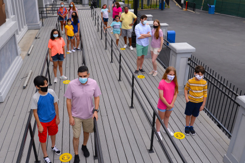 Social distancing markers will be placed in all park entry, ride, restroom, retail locations, and dining queue lines. (Photo: Business Wire)