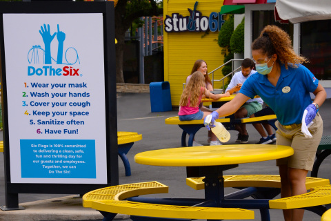 Six Flags clean teams will clean and disinfect high touch points including tabletops, counters, public seating, doors, and trash cans on a regular basis. (Photo: Business Wire)