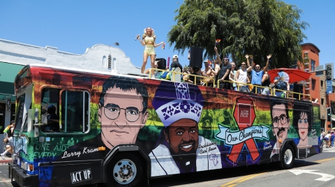 """In 2019, the 50th anniversary of the Stonewall Riots, AHF honored Larry Kramer and seven others as """"Our Champions"""" in the AIDS and LGBTQ+ movements. Their colorful images were seen on a wrapped, double-decker bus at two dozen Pride parades across the country. (Photo: Business Wire)"""