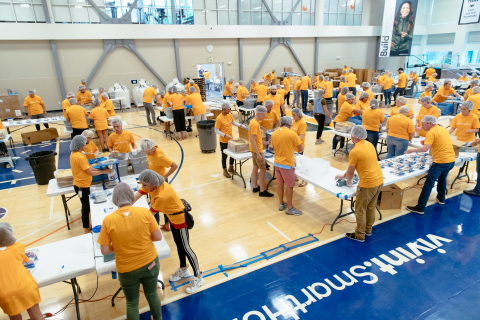 Vivint Smart Home volunteers serving with Feed My Starving Children. (Photo: Business Wire)