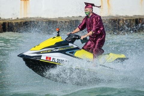 Somerset Island Prep senior jet skis to collect his diploma off the Key West coast. (Photo: Business Wire)