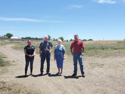 From left to right: P.A.T.H. Executive Director Jennifer Ragsdale, P.A.T.H. President E.C. Ross, P.A.T.H. Board Member and Past President Allene Dering and LP Red Bluff Plant Manager Shannon Bear meet on the donated property at 400 Reeds Avenue in Red Bluff, California, home to the upcoming homeless shelter (Photo: Business Wire)
