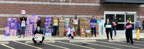 Members of the NWFCU Foundation and Volunteers with Diaper Drive Donations (Photo: Business Wire)