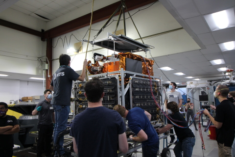 Astranis engineers load their small communications satellite into a thermal-vacuum shroud. (Photo: Business Wire)