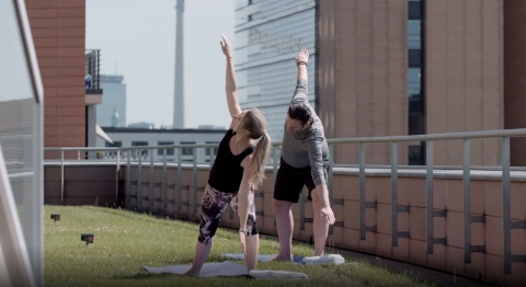 Grand Hyatt Berlin guests enjoy a private rooftop yoga session, a new Hyatt wellness offering designed to encourage social distancing while allowing guests to relax and unwind with peace of mind. CREDIT: Grand Hyatt Berlin