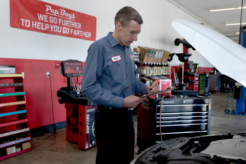 Bryan Lamparter, a master technician who was recently recognized as a Pep Boys 'Top Tech,' the Company's annual award for its best performing technicians who also demonstrate a commitment to customer service and their community, completed much of the work on the family's inoperable 2013 KIA Optima. (Photo: Business Wire)