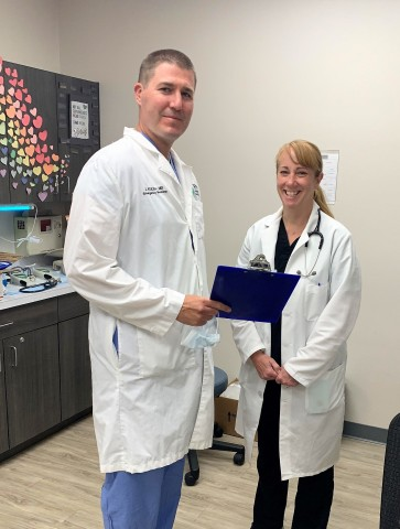 John Kulish, MD, FACEP, Medical Director of IEP Healthy Urgent Care Novi & Southfield reviews information with Elizabeth Luke, PA-C, one of the IEP Healthy Urgent Care providers. (Photo: Business Wire)
