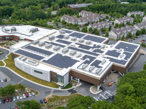 Aerial view of Insulet Global Headquarters (left) and U.S. Manufacturing Facility (right) in Acton, MA, with solar panels installed on the roof. (Photo: Business Wire)