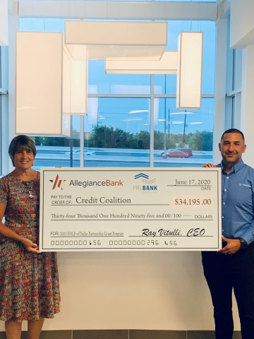 Sherrie Young (left), executive director of the Credit Coalition, and Rickey Jimenez, Jr., vice president, CRA and fair lending officer for Allegiance Bank in Houston, hold an oversized check symbolizing the $34K grant that Allegiance Bank and the Federal Home Loan Bank of Dallas recently presented to the Houston nonprofit. (Photo: Business Wire)