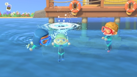Grab a wet suit in Animal Crossing: New Horizons and get acquainted with your island marine life. Swim in the inviting waters off the coast of your island and dive to discover and scoop up sea creatures. (Photo: Business Wire)