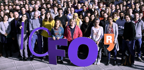 "ICFONIANS UNITED: Researchers, staff, and students celebrate their logo. The ""R"" stands for ""recerca,"" the Catalan word for ""research."" This was part of the original branding of the research institutes established by the government of Catalonia a little over 20 years ago, and ICFO retains it in their logo. (Photo: Business Wire)"