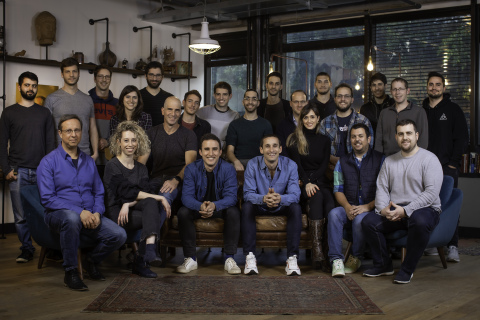 Hunters team. Co-founders Uri May, CEO (l.) and Tomer Kazaz, CTO (r.) seated in the front row center (Photo: Business Wire)