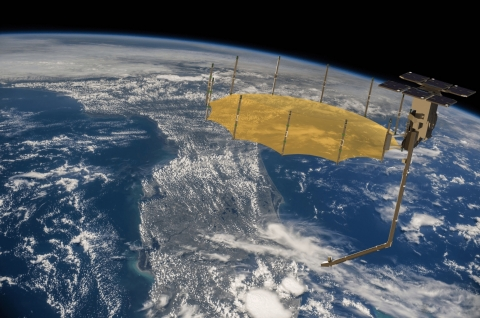 Artist concept of a Capella synthetic aperture radar satellite. Capella uses AWS services and infrastructure, including AWS Ground Station, to communicate with its satellites, and then downlink, process, and distribute satellite data within minutes of its capture. (Courtesy Capella Space; background image courtesy NASA)