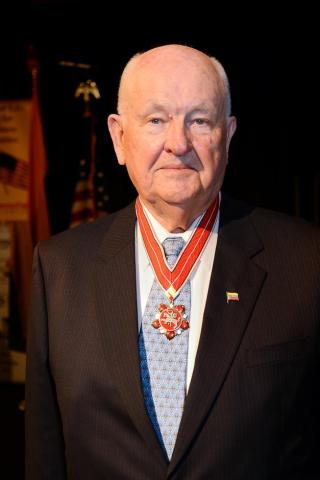 Albinas Markevicius during a 2013 ceremony receiving the Medal of Diplomacy from the Lithuanian Embassy in Washington, D.C. (Photo: Business Wire)