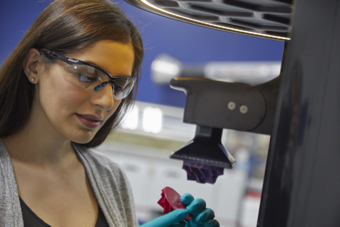 An engineer inspects a urethane methacrylate (UMA) impeller that was 3D printed using digital light synthesis (DLS) technology. (Photo: Business Wire)