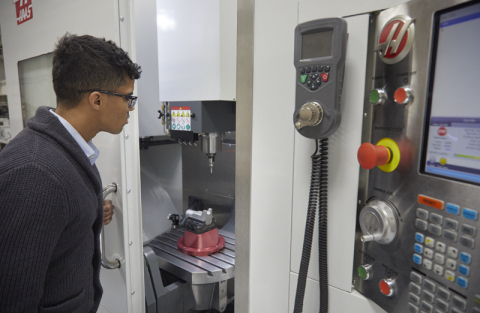A technician performing setup and machining of a 15-5 stainless steel aerospace part, which was 3D printed using Laser Powder Bed Fusion on an EOS M290 3D printer. (Photo: Business Wire)