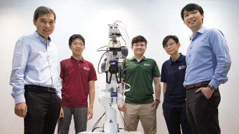 The National University of Singapore research team behind the novel robotic system integrated with event-driven artificial skin and vision sensors was led by assistant professor Harold Soh (left) and assistant professor Benjamin Tee (right). With them are team members (second from left to right) Sng Weicong, Tasbolat Taunyazov and See Hian Hian. (Credit: National University of Singapore)