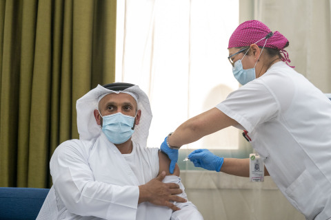 H.E. Sheikh Abdullah bin Mohammed Al Hamed, Chairman of Department of Health, Abu Dhabi, being administered the world's first clinical Phase III trial of inactivated vaccine to combat COVID-19 (Photo - AETOSWire).