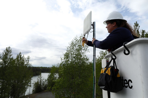 Alaska Communications Field Technician Kristine Barber installs fixed wireless at a home in Sterling, Alaska. (Photo: Business Wire)