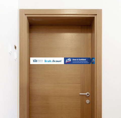 Lysol door wrap for ACC student apartments (Photo: Business Wire)