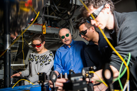 David Awschalom, physicist at UChicago and Argonne National Laboratory, reviews data from a quantum information experiment with graduate students in his lab.  (Image by UChicago)