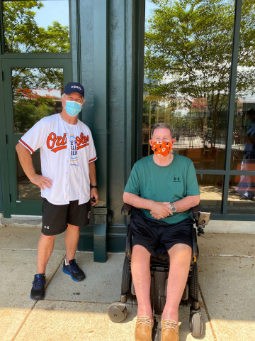 Dr. Dave Mayer was joined by Jack Gentry at the finish line on his most recent walk to Camden yards. (Photo: Business Wire)