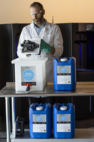 Nexa3D Head of Customer Success Brent Zollinger with the company's new eco-friendly cleaning solvent xCLEAN. (Photo: Business Wire)