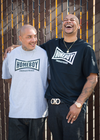 """We used to be worst enemies on the streets and now we're family at Homeboys."" Edwin Ramos, Homeboy Trainee (left) and Jermaine Smith, Homeboy Navigator (right). Homeboy Industries is a unique place where former gang members are able to experience healing from their violent pasts within the context of kinship. It is a place of hope where work therapy, mentorship, education, tattoo removal and many other vital re-entry services are offered so people can have a second chance at life. (Photo: Business Wire)"