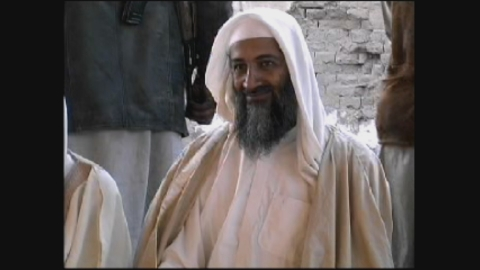 Osama bin Laden sitting at a gathering. (Karga Seven Pictures)