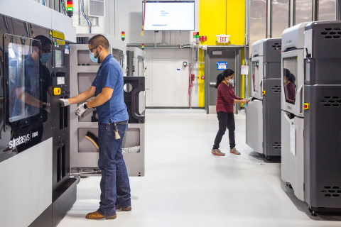 General Motors additive manufacturing team members working at the under-construction Additive Innovation Center. (Photo: Business Wire)